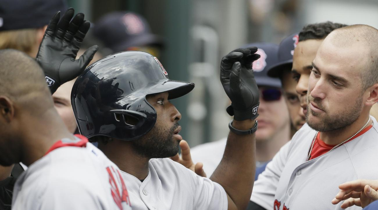 Boston Red Sox's Jackie Bradley Jr. is congratulated by teammates after his solo home run off Detroit Tigers pitcher Tom Gorzelanny during the seventh inning of a baseball game, Sunday, Aug. 9, 2015, in Detroit. (AP Photo/Carlos Osorio)