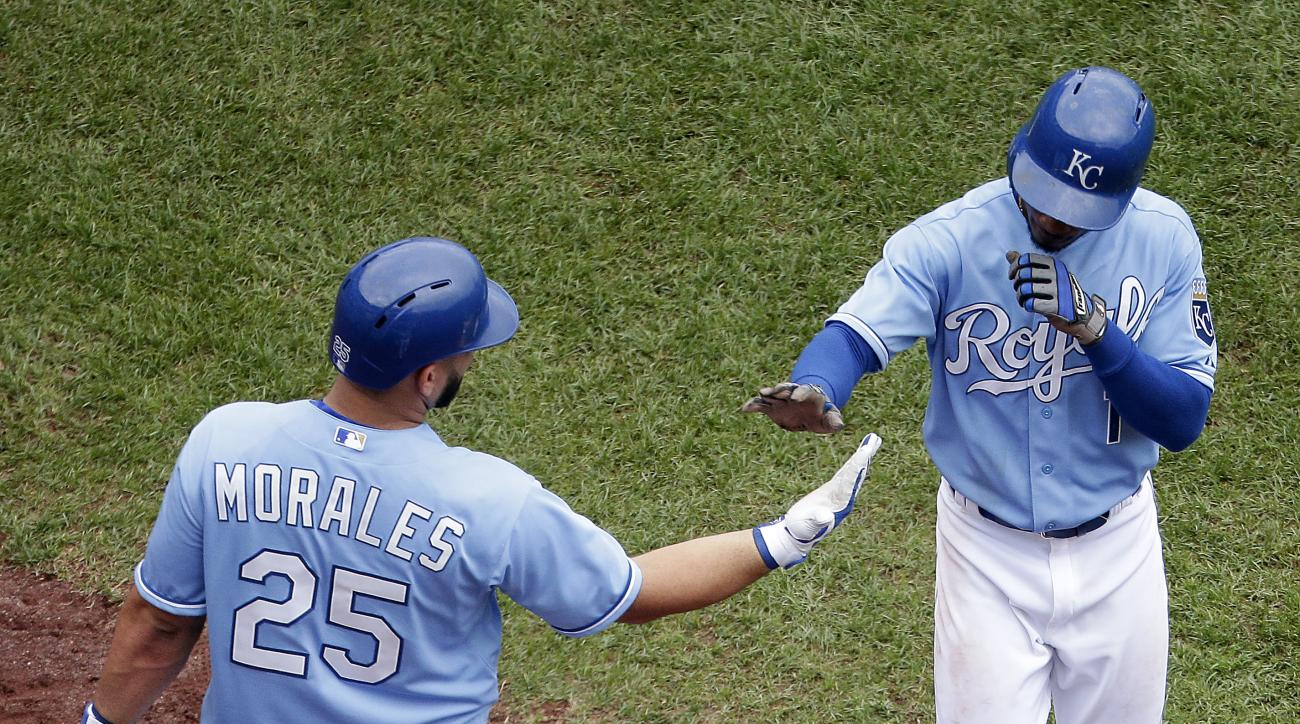 Kansas City Royals' Jarrod Dyson (1) celebrates with Kendrys Morales after scoring on a single by Ben Zobrist during the fifth inning of a baseball game against the Chicago White Sox, Sunday, Aug. 9, 2015, in Kansas City, Mo. (AP Photo/Charlie Riedel)