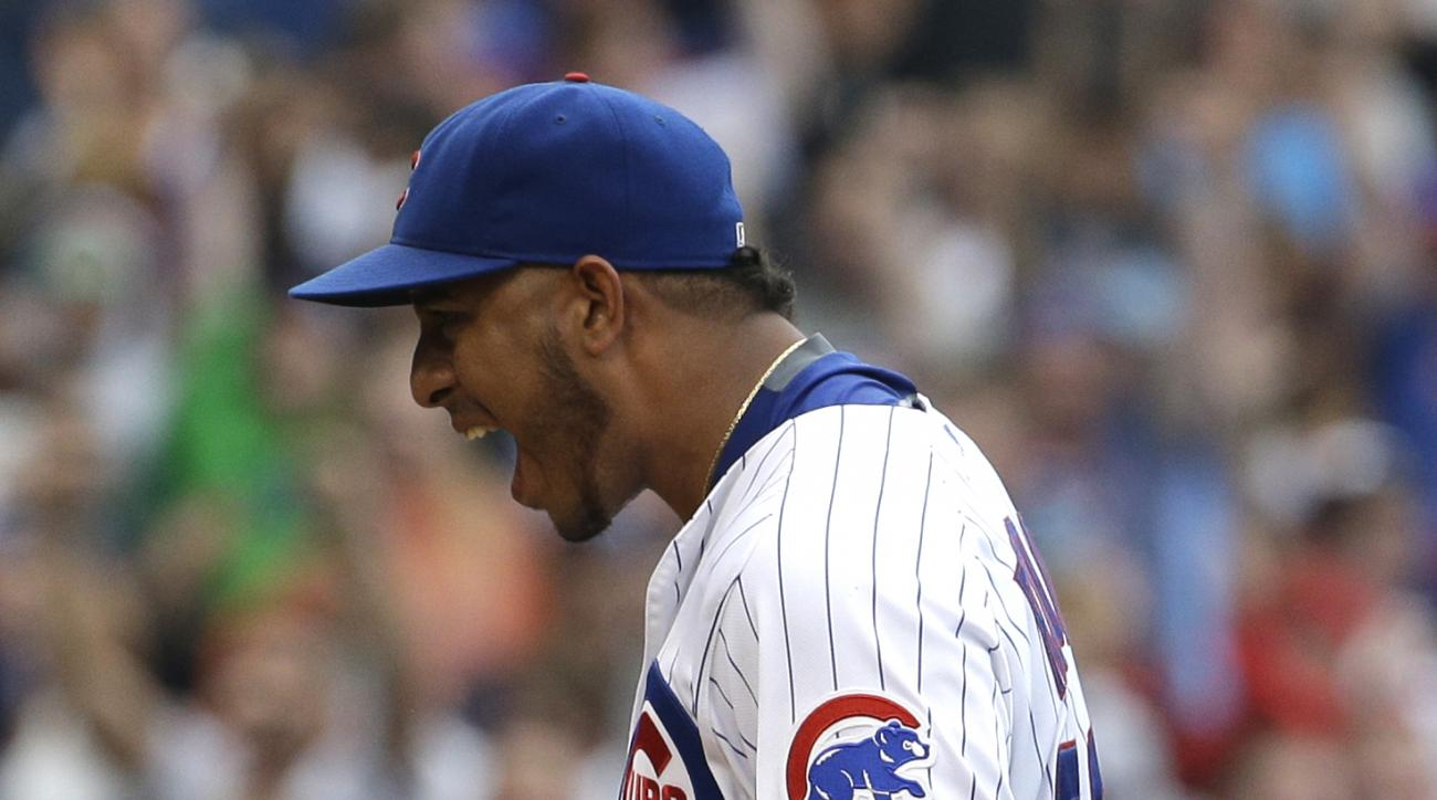 Chicago Cubs relief pitcher Hector Rondon reacts after the Cubs defeated the San Francisco Giants 2-0 in a baseball game, Sunday, Aug. 9, 2015, in Chicago. (AP Photo/Nam Y. Huh)