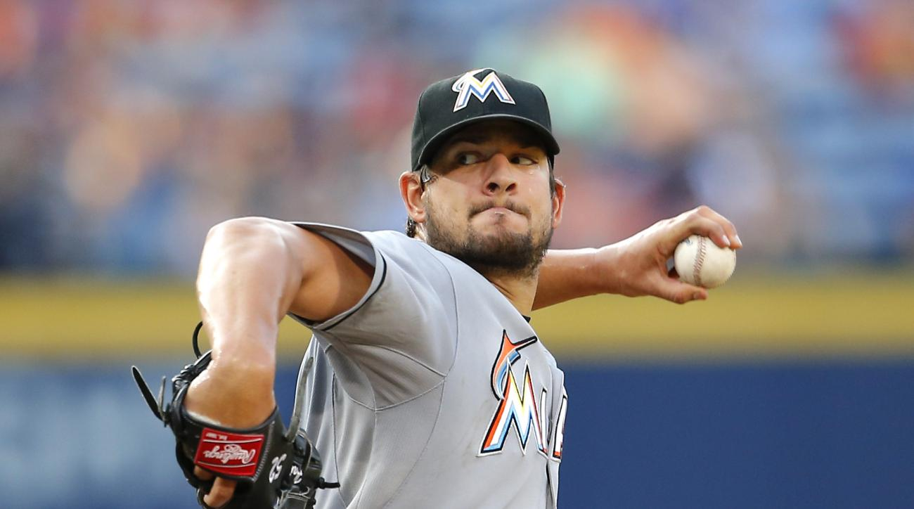 Miami Marlins starting pitcher Brad Hand (52) delivers in the sixth inning of a baseball game against the Atlanta Braves, Sunday, Aug. 9, 2015, in Atlanta. (AP Photo/Todd Kirkland)
