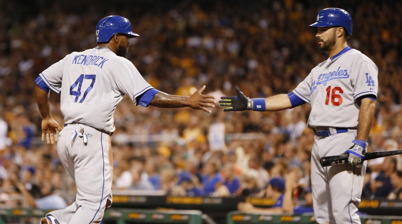 Los Angeles Dodgers' Howie Kendrick (47) is greeted by on deck batter Andre Ethier (16) after scoring on a hit by Adrian Gonzalez in the third inning of a baseball game against the Los Angeles Dodgers, Sunday, Aug. 9, 2015, in Pittsburgh. (AP Photo/Keith