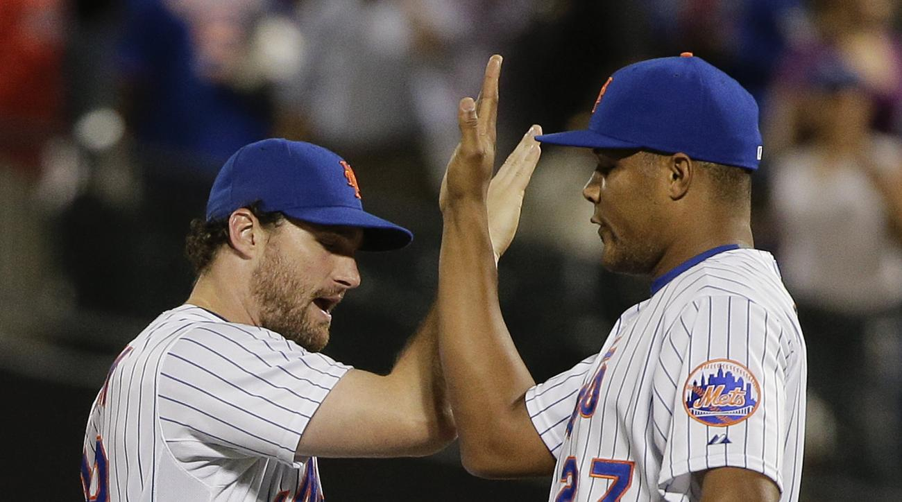 New York Mets' Daniel Murphy, left, high fives  pitcher Jeurys Familia, right, after the Mets beat the Colorado Rockies 4-2 in a baseball game, Monday, Aug. 10, 2015, in New York. (AP Photo/Julie Jacobson)