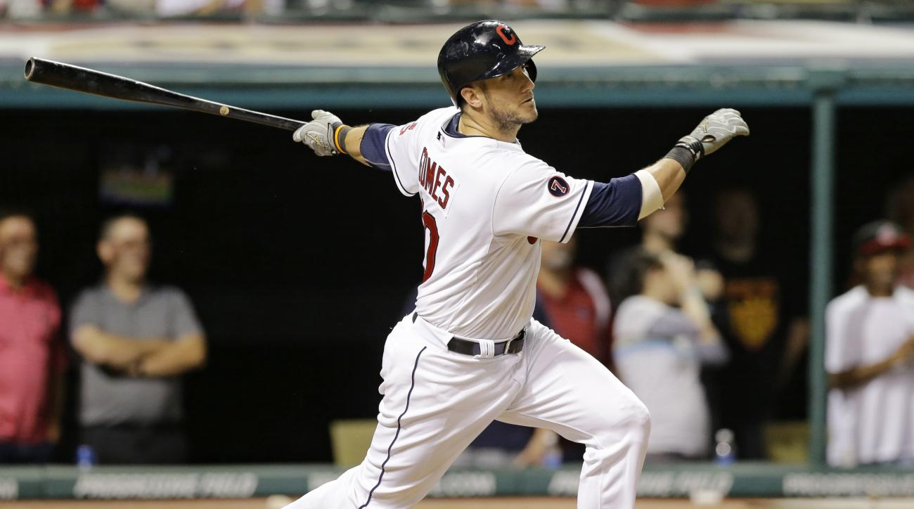Cleveland Indians' Yan Gomes hits an RBI-single off New York Yankees relief pitcher Andrew Miller in the tenth inning of a baseball game, Tuesday, Aug. 11, 2015, in Cleveland. Michael Brantley scored on the play. (AP Photo/Tony Dejak)