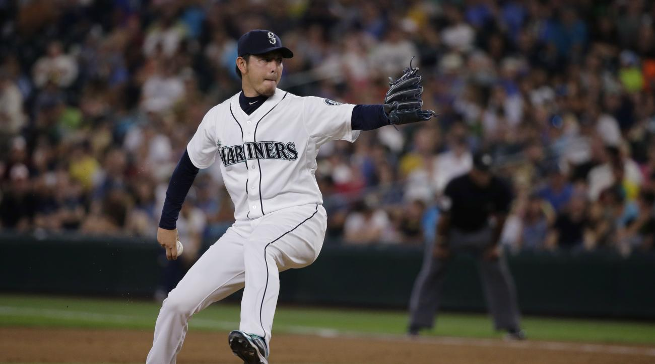 Seattle Mariners starting pitcher Hisashi Iwakuma throws to a Baltimore Orioles batter during the fifth inning of a baseball game, Wednesday, Aug. 12, 2015, in Seattle. (AP Photo/Ted S. Warren)