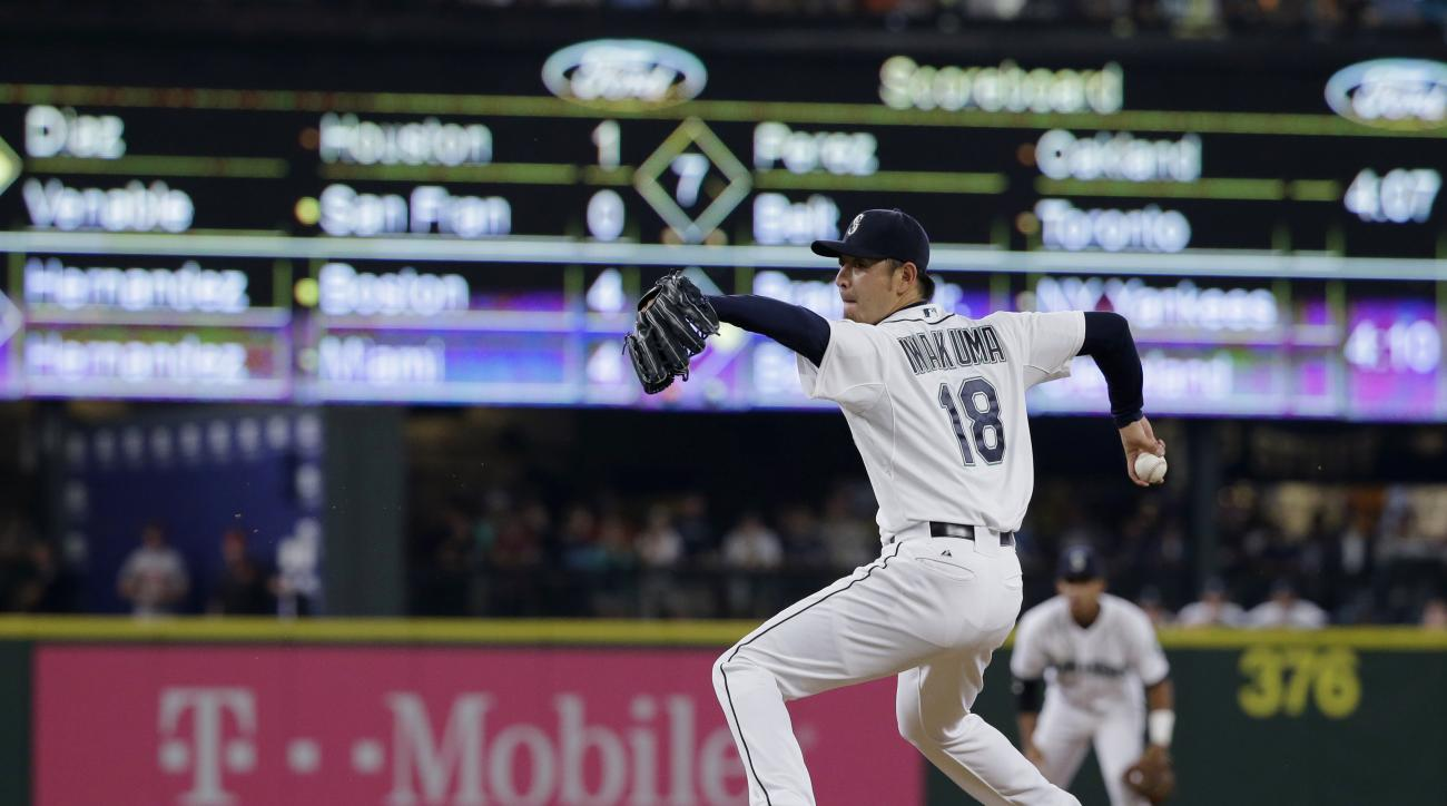 Seattle Mariners starting pitcher Hisashi Iwakuma throws during the eighth inning of a baseball game against the Baltimore Orioles, Wednesday, Aug. 12, 2015, in Seattle. (AP Photo/Ted S. Warren)