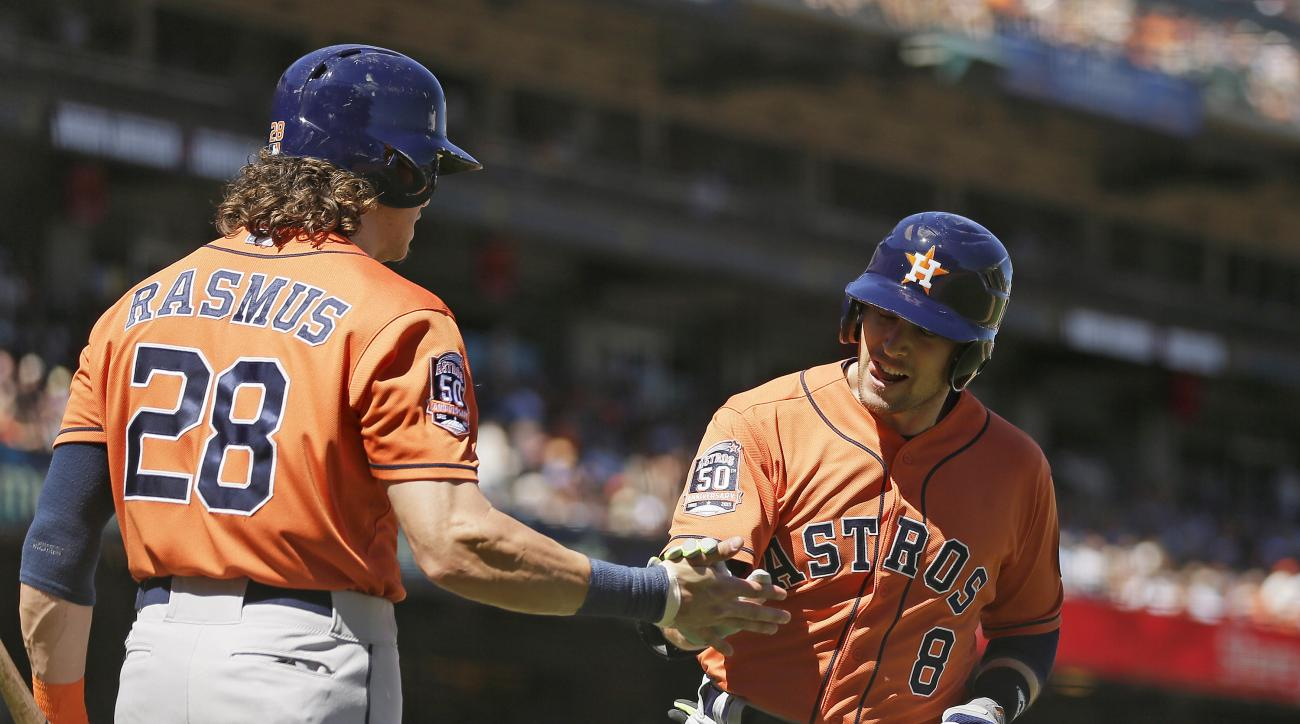 Houston Astros' Jed Lowrie, right, is greeted by Colby Rasmus after hitting a home run off San Francisco Giants relief pitcher George Kontos during the eighth inning of a baseball game Wednesday, Aug. 12, 2015, in San Francisco. Houston won 2-0. (AP Photo