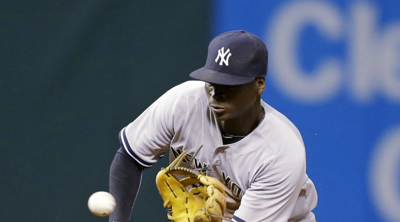 New York Yankees' Didi Gregorius fields a ball hit by Cleveland Indians' Francisco Lindor during the seventh inning of a baseball game, Wednesday, Aug. 12, 2015, in Cleveland. Lindor was out on the play. (AP Photo/Tony Dejak)