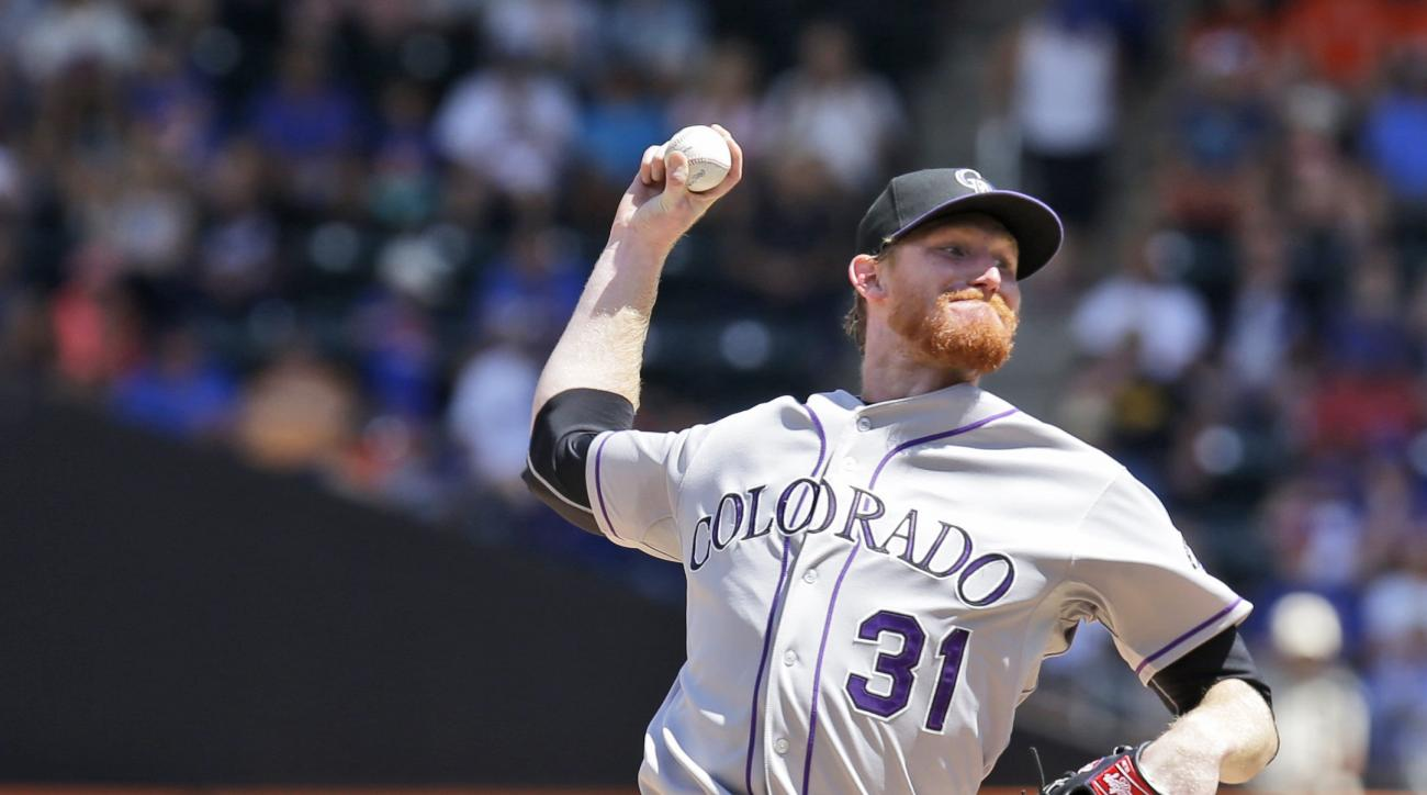 Colorado Rockies starting pitcher Eddie Butler throws during the first inning of a baseball game against the New York Mets at Citi Field, Thursday, Aug. 13, 2015 in New York. (AP Photo/Seth Wenig)