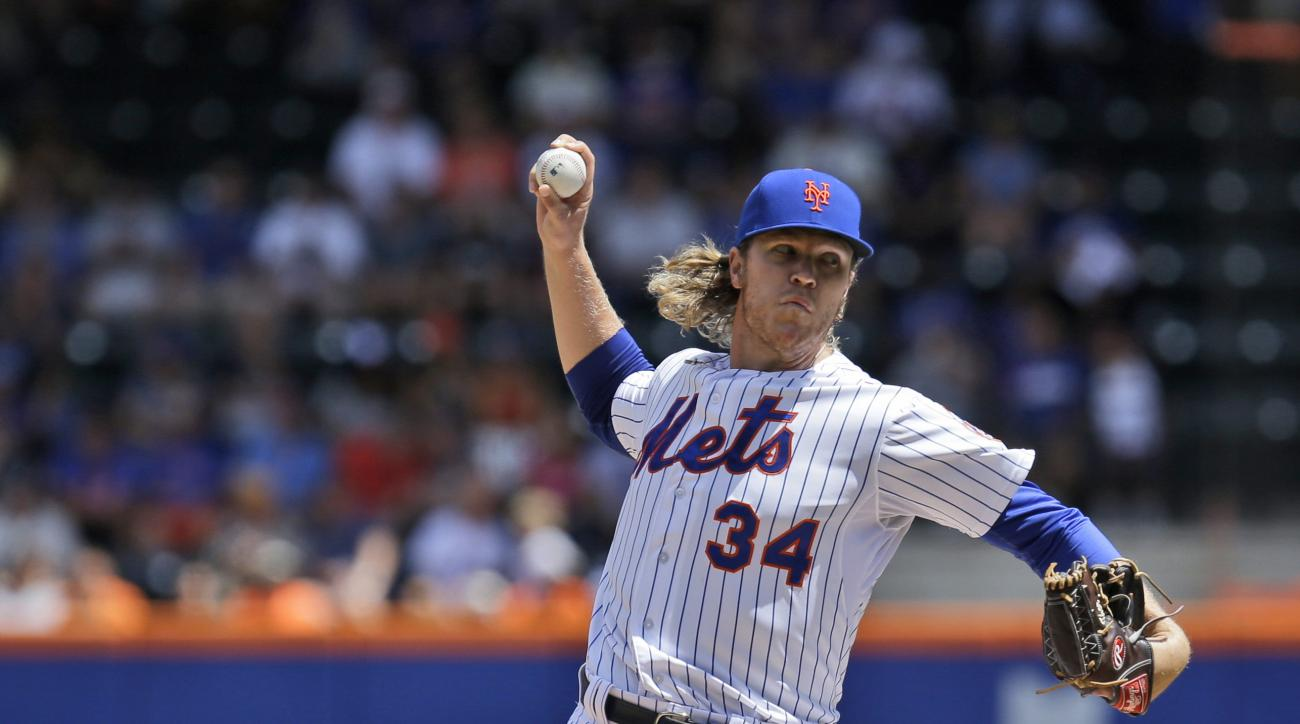 New York Mets starting pitcher Noah Syndergaard throws during the second inning of a baseball game against the Colorado Rockies at Citi Field, Thursday, Aug. 13, 2015, in New York. (AP Photo/Seth Wenig)