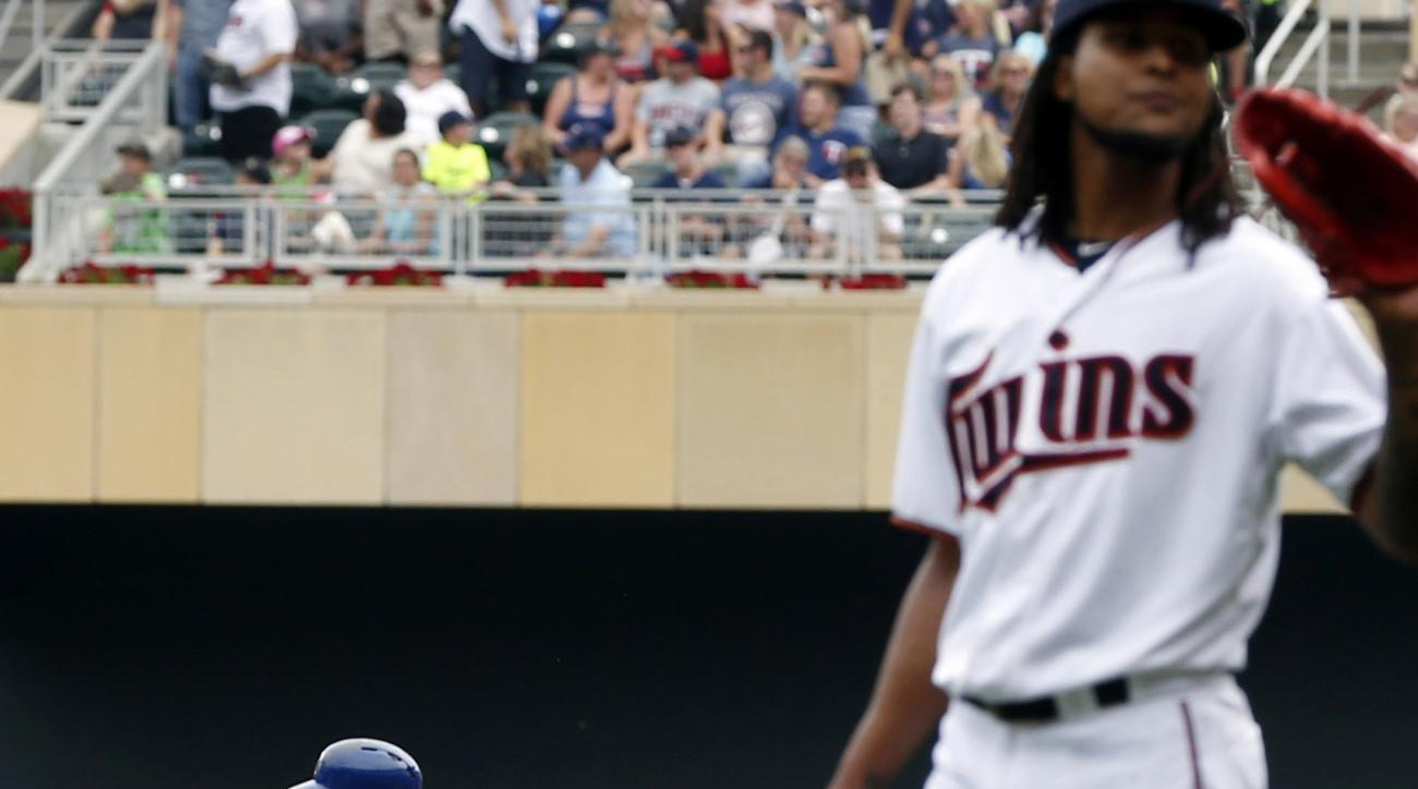 Texas Rangers' Mitch Moreland, left, rounds the bases with a two-run home run off Minnesota Twins pitcher Ervin Santana in the fourth inning of a baseball game, Thursday, Aug. 13, 2015, in Minneapolis. (AP Photo/Jim Mone)
