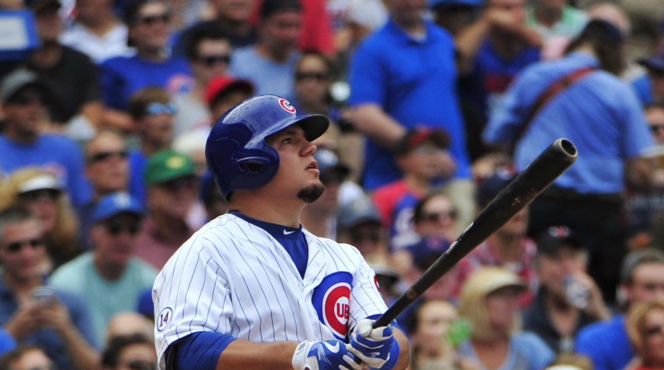 Chicago Cubs' Kyle Schwarber watches his home run against the Milwaukee Brewers during the fifth inning of a baseball game, Thursday, Aug. 13, 2015, in Chicago. (AP Photo/David Banks)