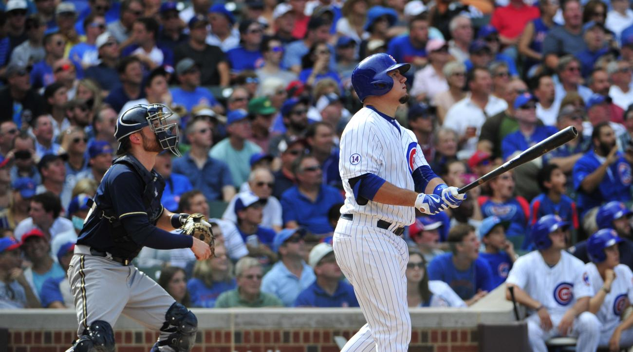 Chicago Cubs' Kyle Schwarber watches his two-run home run against the Milwaukee Brewers during the seventh inning of a baseball game, Thursday, Aug. 13, 2015, in Chicago. (AP Photo/David Banks)