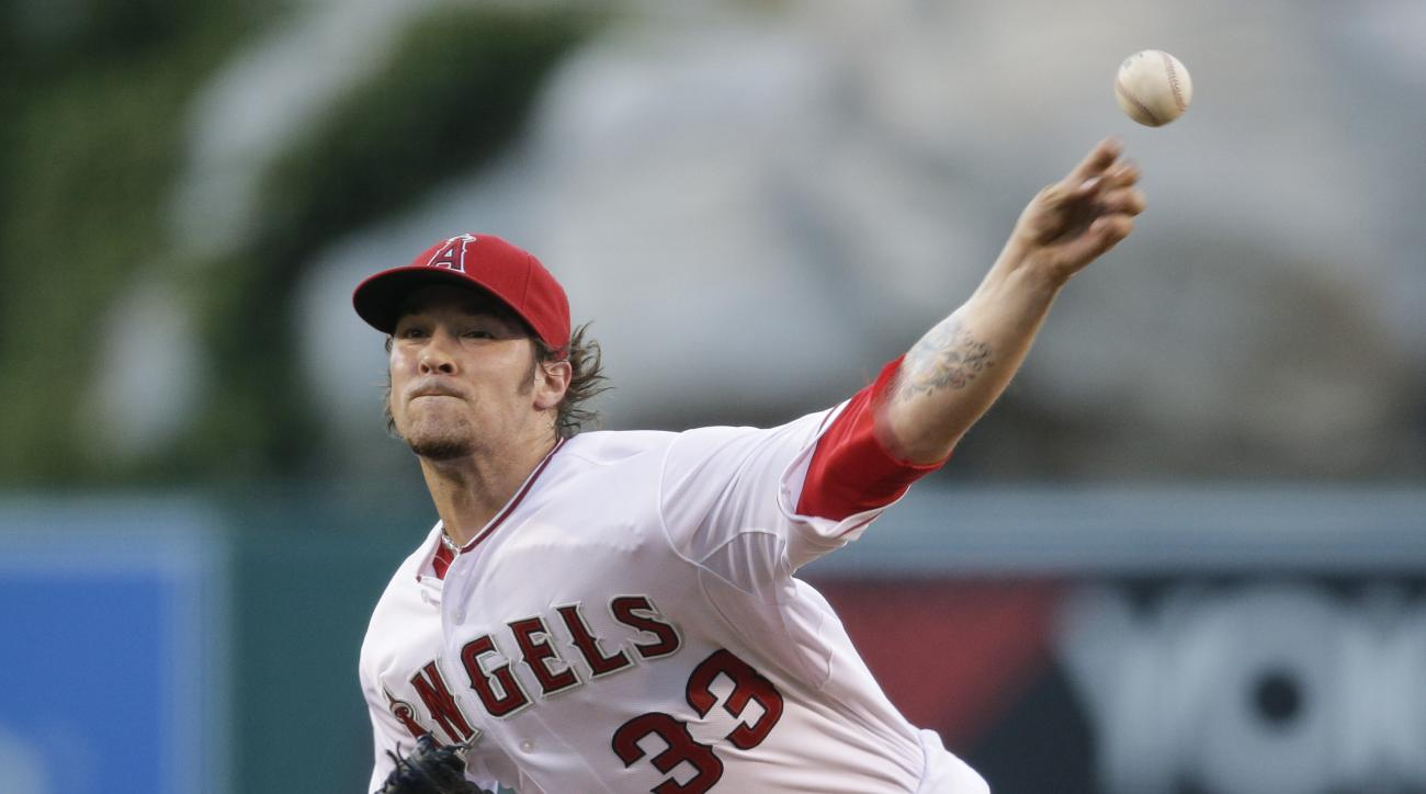 Los Angeles Angels starting pitcher C.J. Wilson throws against the Minnesota Twins during the first inning of a baseball game, Wednesday, July 22, 2015, in Anaheim, Calif. (AP Photo/Jae C. Hong)