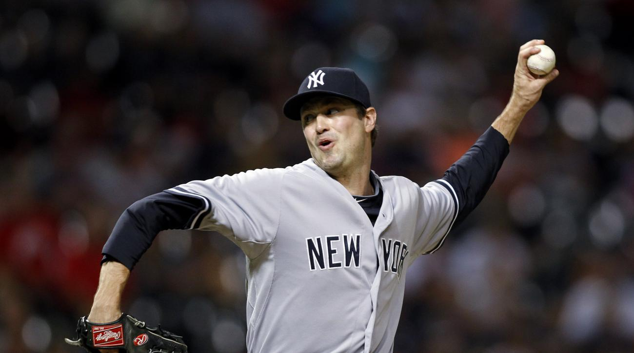 New York Yankees' Andrew Miller pitches during the ninth inning of a baseball game against the Cleveland Indians on Thursday, Aug. 13, 2015, in Cleveland. The Yankees won 8-6. (AP Photo/Aaron Josefczyk)