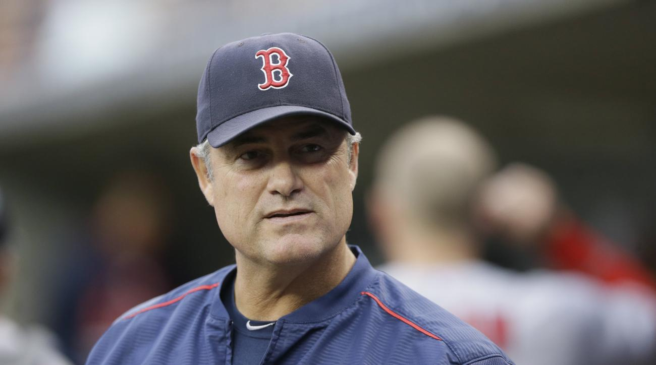 FILE - In this Saturday, Aug. 8, 2015 file photo, Boston Red Sox manager John Farrell watches from the dugout during the first inning of a baseball game against the Detroit Tigers in Detroit. Boston Red Sox manager John Farrell says he has lymphoma and is