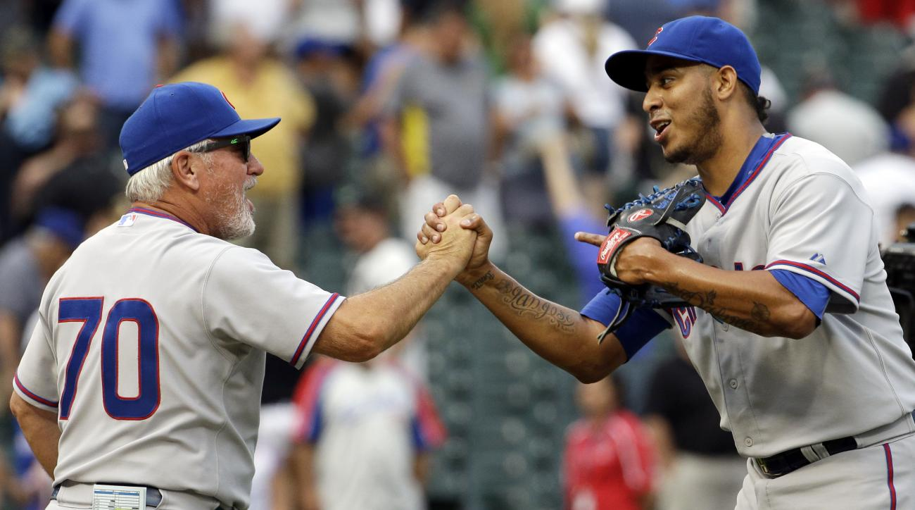 Chicago Cubs closer Hector Rondon, right, celebrates with manager Joe Maddon after the Cubs defeated the Chicago White Sox 6-5 in an interleague baseball game Friday, Aug. 14, 2015, in Chicago. (AP Photo/Nam Y. Huh)