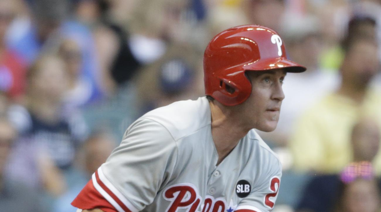 Philadelphia Phillies' Chase Utley watches his home run against the Milwaukee Brewers during the third inning of a baseball game Saturday, Aug. 15, 2015, in Milwaukee. (AP Photo/Jeffrey Phelps)