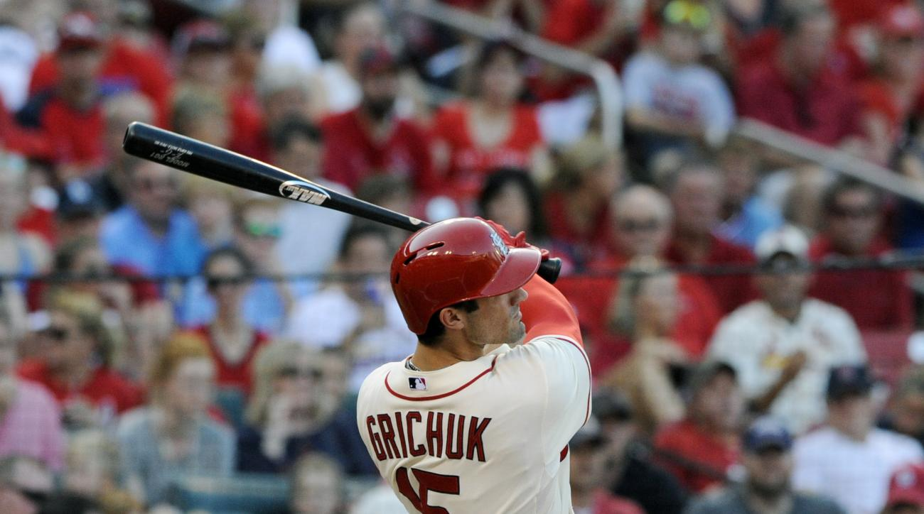 St. Louis Cardinals' Randal Grichuk (15) watches his solo home run against the Miami Marlins in the first inning of a baseball game, Saturday, Aug. 15, 2015, at Busch Stadium in St. Louis. (AP Photo/Bill Boyce)