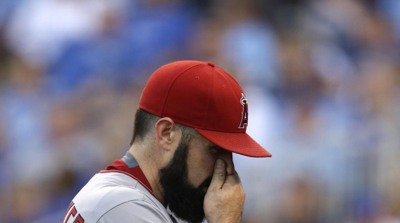 Los Angeles Angels starting pitcher Matt Shoemaker leaves the baseball game against the Kansas City Royals during the second inning at Kauffman Stadium in Kansas City, Mo., Saturday, Aug. 15, 2015. (AP Photo/Orlin Wagner)