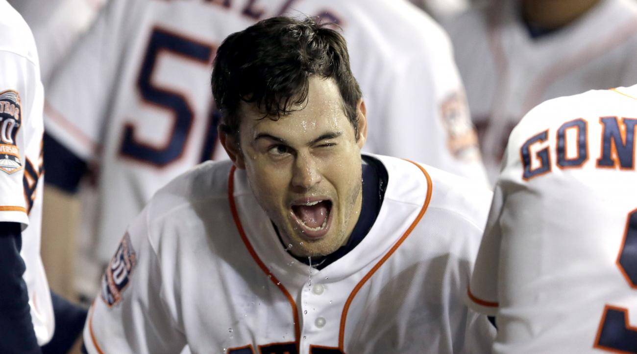 Houston Astros' Preston Tucker gets a face full of water in the dugout after hitting a solo home run against the Detroit Tigers to tie the baseball game during the ninth inning against the Detroit Tigers on Saturday, Aug. 15, 2015, in Houston. (AP Photo/P