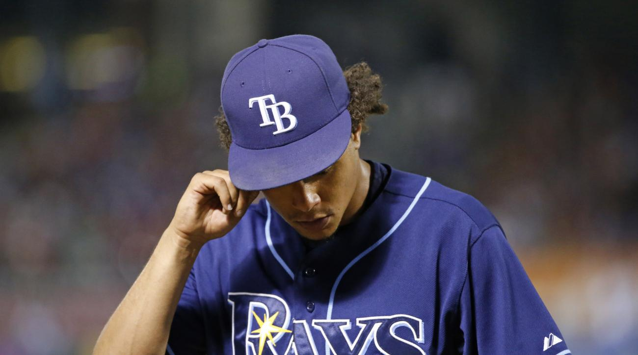 Tampa Bay Rays starting pitcher Chris Archer leaves the baseball game during the sixth innig against the Texas Rangers on Saturday, Aug. 15, 2015, in Arlington, Texas. (AP Photo/Ron Jenkins)