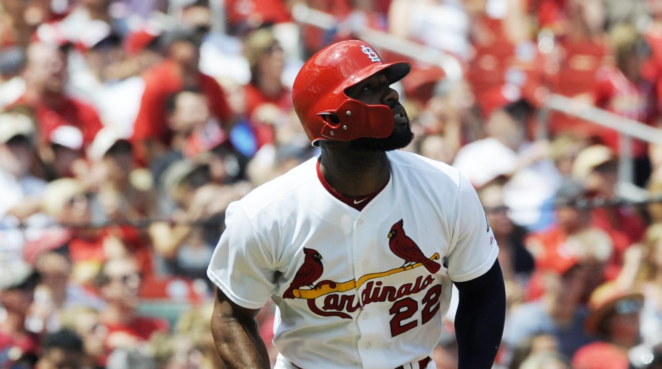 St. Louis Cardinals' Jason Heyward (22) watches his solo home run against the Miami Marlins in the first inning of a baseball game, Sunday, Aug. 16, 2015, at Busch Stadium in St. Louis. (AP Photo/Bill Boyce)