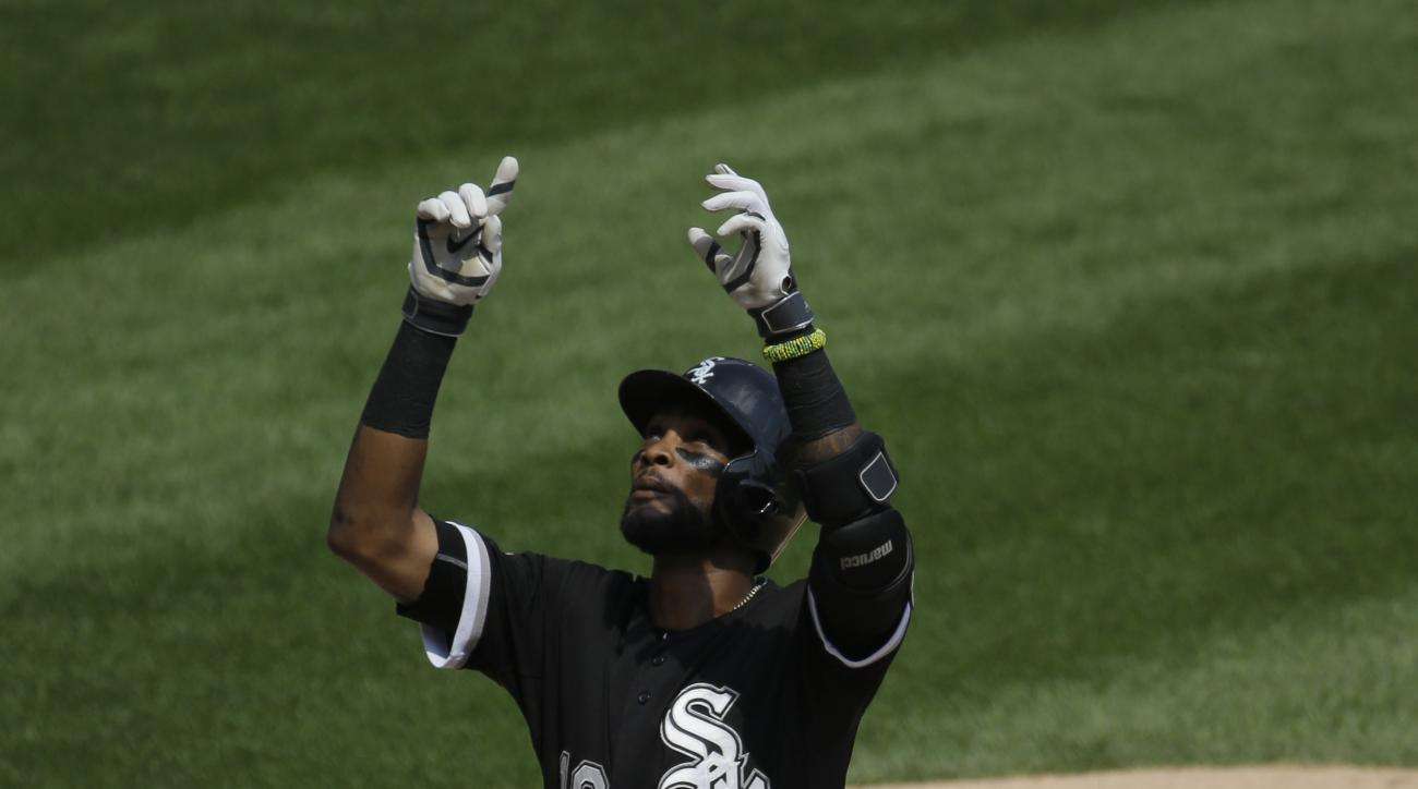 Chicago White Sox's Alexei Ramirez celebrates after hitting a solo home run during the fourth inning of an interleague baseball game against the Chicago Cubs Sunday, Aug. 16, 2015, in Chicago. (AP Photo/Nam Y. Huh)