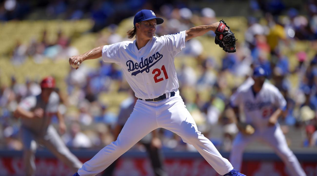 Los Angeles Dodgers starting pitcher Zack Greinke throws to the plate during the second inning of a baseball game against the Cincinnati Reds, Sunday, Aug. 16, 2015, in Los Angeles. (AP Photo/Mark J. Terrill)