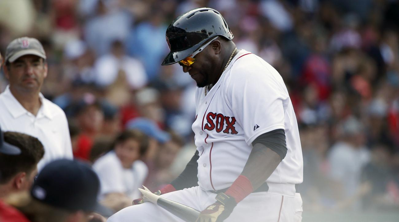 Boston Red Sox's David Ortiz breaks his bat over his knee after striking out during the eleventh inning of a baseball gamea gainst the Seattle Mariners in Boston, Sunday, Aug. 16, 2015. (AP Photo/Michael Dwyer)