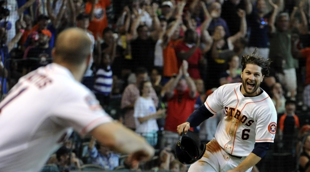 Houston Astros' Jake Marisnick (6) celebrates after scoring the winning run in the ninth inning of a baseball game against the Detroit Tigers, Sunday, Aug. 16, 2015 in Houston. The Astros won the game, 5-4. (AP Photo/Eric Christian Smith)