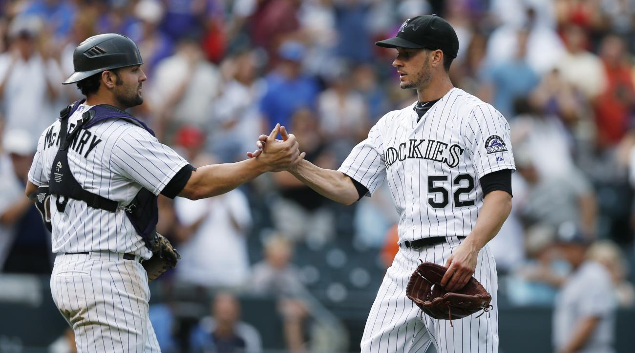 Colorado Rockies catcher Michael McKenry, left, congratulates starting pitcher Chris Rusin after Rusin retired San Diego Padres' Jedd Gyorko in the ninth inning of a baseball game Sunday, Aug. 16, 2015, in Denver. The Rockies won 5-0. (AP Photo/David Zalu