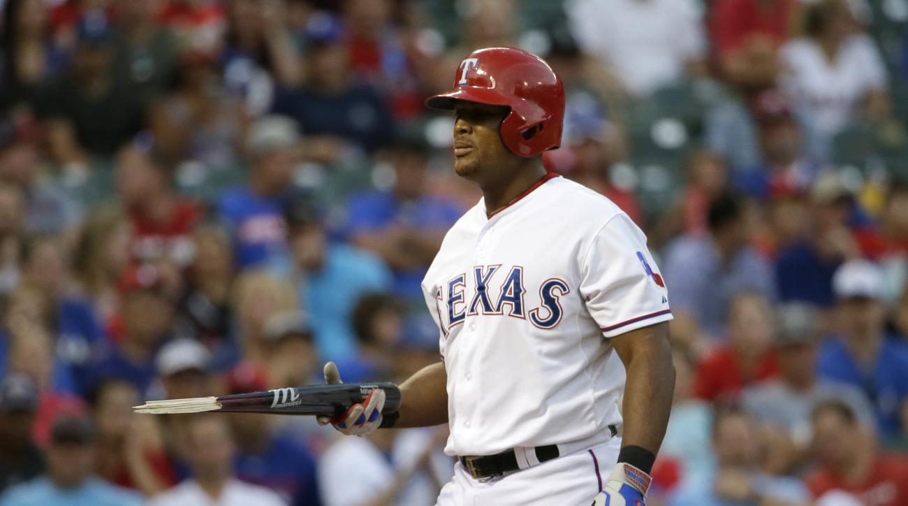 Texas Rangers Adrian Beltre collects his broken bat during the third inning of a baseball game against the Seattle Mariners in Arlington, Texas, Monday, Aug. 17, 2015. (AP Photo/LM Otero)