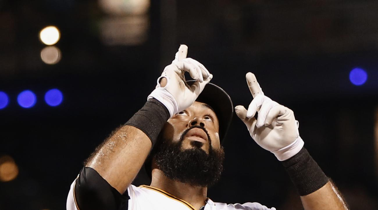 Pittsburgh Pirates' Pedro Alvarez points skyward as he touches home plate after hitting a solo home run in the fifth inning of a baseball game against the Arizona Diamondbacks, Monday, Aug. 17, 2015, in Pittsburgh. (AP Photo/Keith Srakocic)