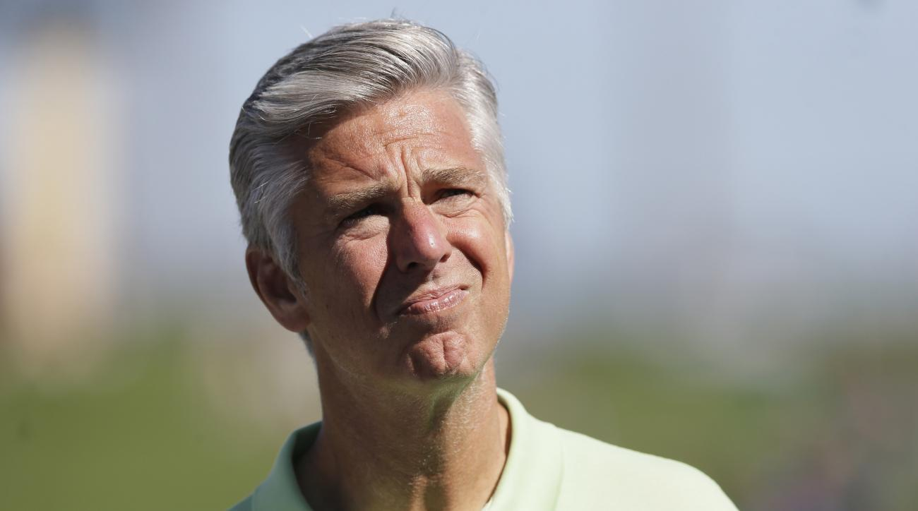 FILE - In this March 17, 2015, file photo, Dave Dombrowski, then-Detroit Tigers general manager, waits for a spring training baseball game between the Tigers and the Washington Nationals in Lakeland, Fla. The Boston Red Sox have hired former Tigers boss D