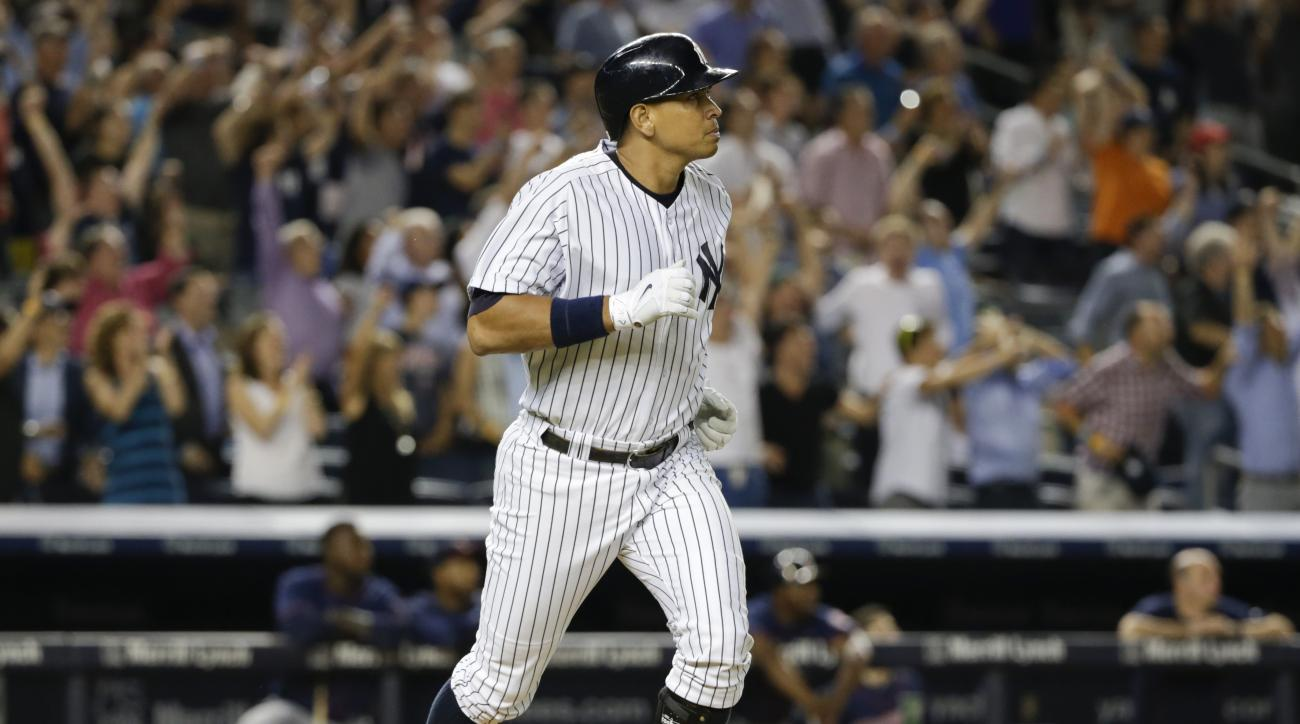 New York Yankees' Alex Rodriguez watches his grand slam as he runs to first during the seventh inning of a baseball game against the Minnesota Twins on Tuesday, Aug. 18, 2015, in New York. (AP Photo/Frank Franklin II)