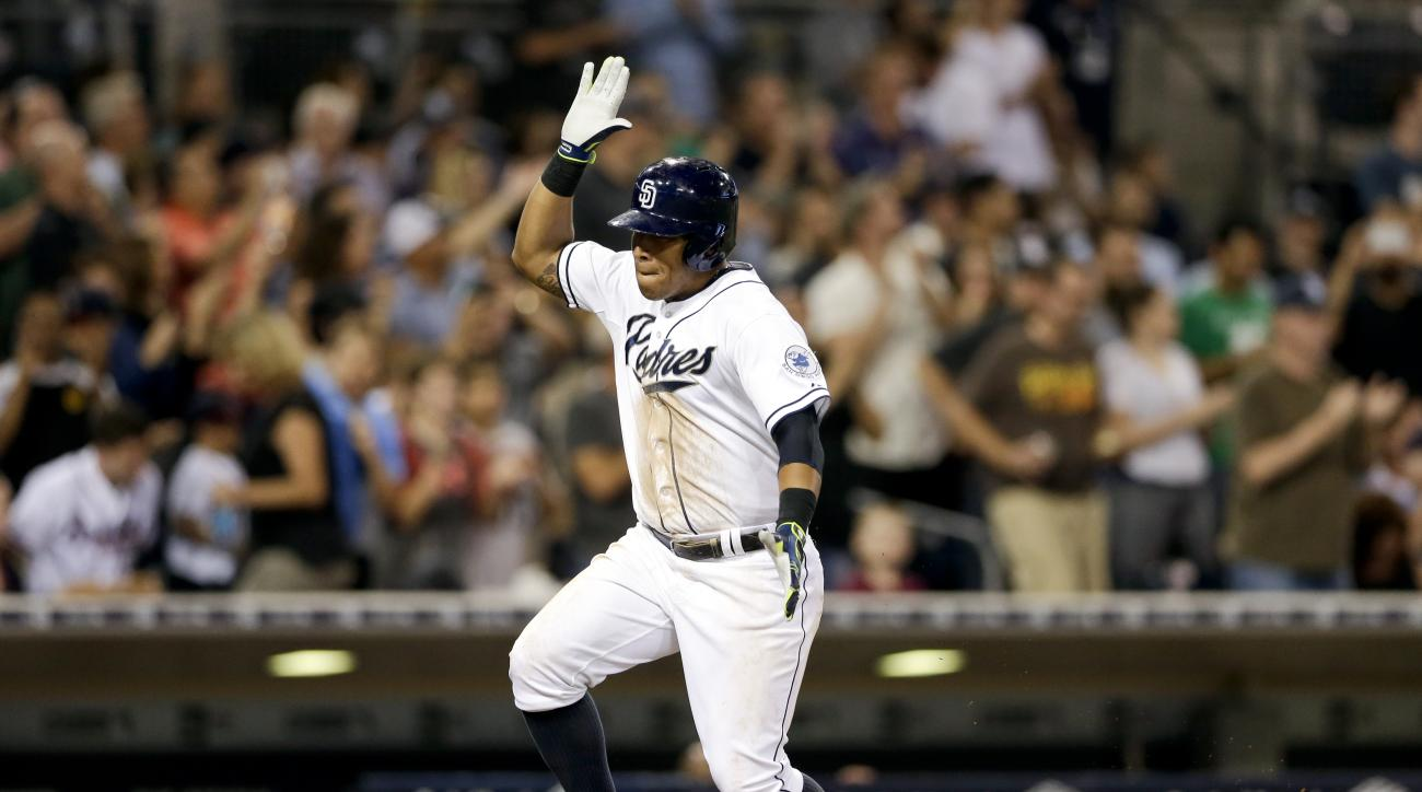 San Diego Padres' Yangervis Solarte reacts as he rounds the bases after hitting a three-run home run against the Atlanta Braves during the sixth inning of a baseball game Tuesday, Aug. 18, 2015, in San Diego. (AP Photo/Gregory Bull)