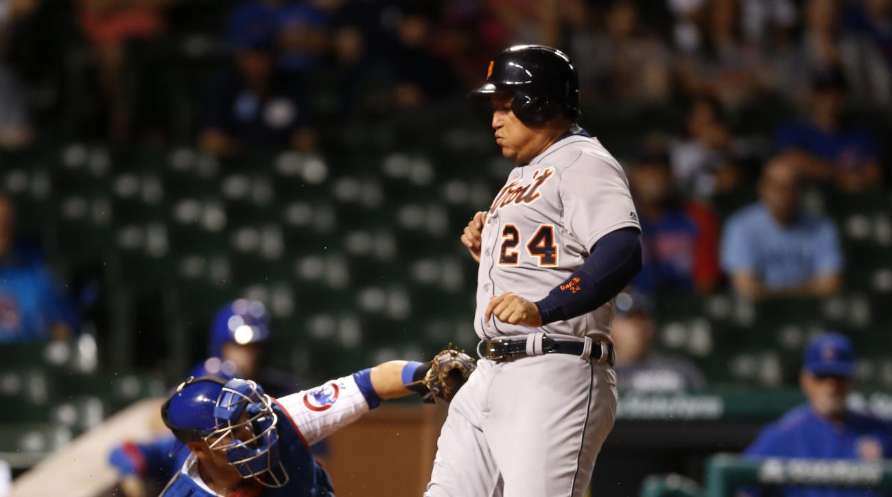Detroit Tigers' Miguel Cabrera, right, scores past Chicago Cubs catcher Miguel Montero off a single by Nick Castellanos, during the eighth inning of a baseball game Wednesday, Aug. 19, 2015, in Chicago. (AP Photo/Charles Rex Arbogast)