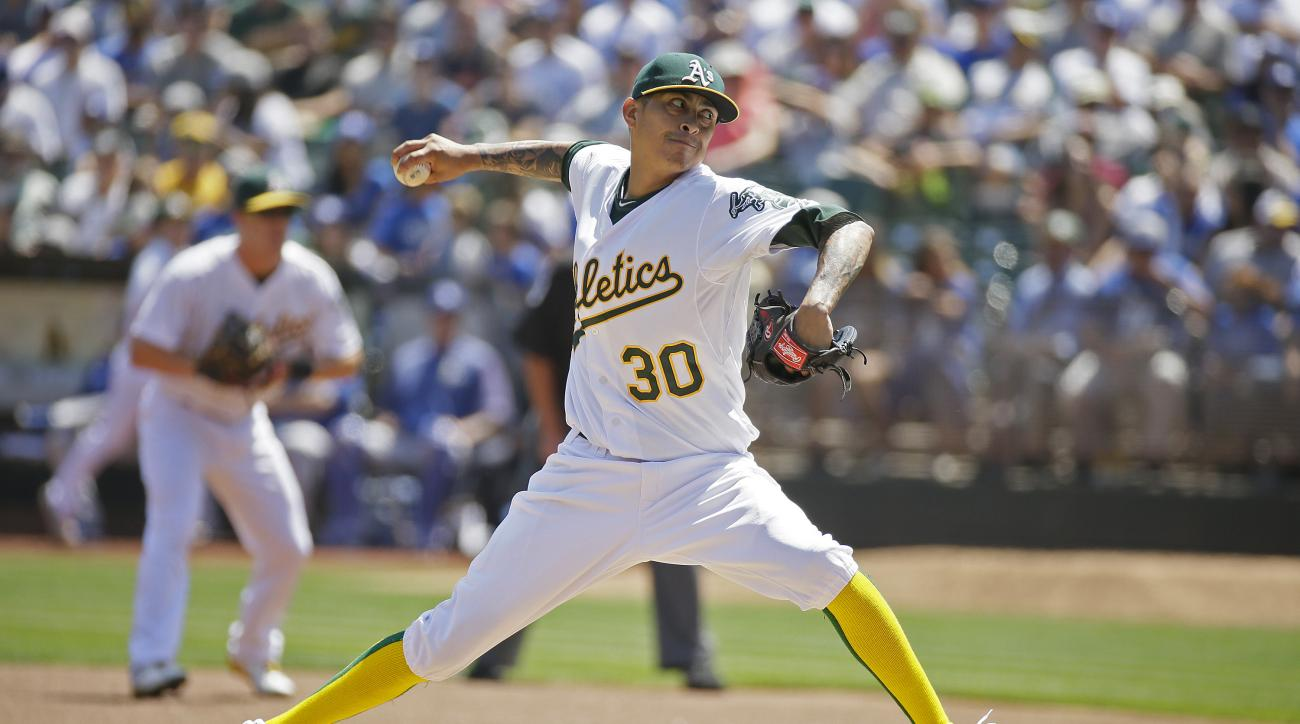 Oakland Athletics starting pitcher Jesse Chavez throws in the first inning of a baseball game against the Los Angeles Dodgers Wednesday, Aug. 19, 2015, in Oakland, Calif. (AP Photo/Eric Risberg)