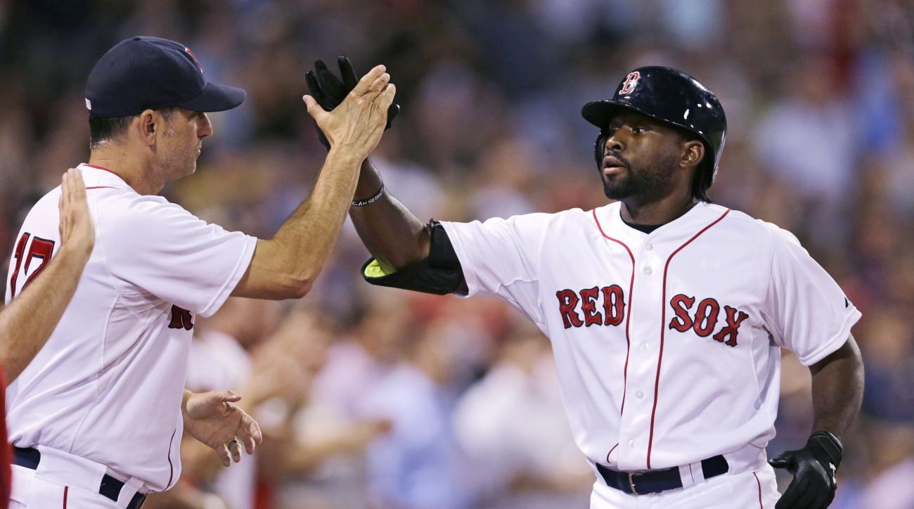 Boston Red Sox's Jackie Bradley Jr., right, is congratulated by Boston Red Sox interim manager Torey Lovullo after his three-run home run off Cleveland Indians starting pitcher Corey Kluber during the fourth inning of a baseball game at Fenway Park in Bos