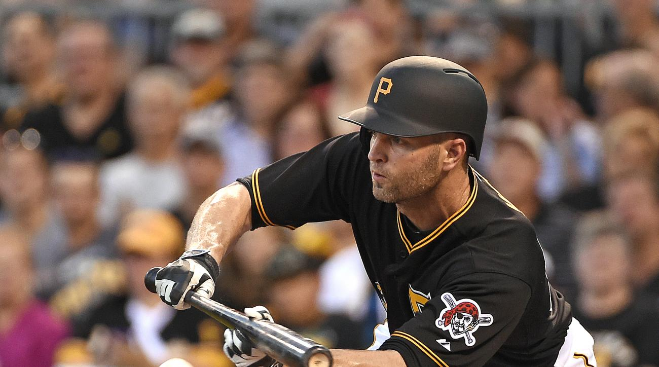 Pittsburgh Pirates' J.A. Happ attempts a sacrifice bunt during the second inning of a baseball game against the Arizona Diamondbacks on Wednesday, Aug. 19, 2015, in Pittsburgh. Sean Rodriguez was forced out at second, and Happ was safe at first. (AP Photo