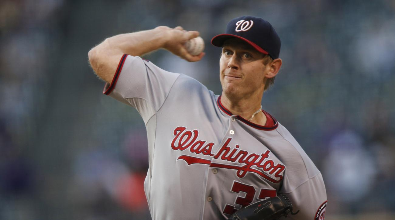 Washington Nationals starting pitcher Stephen Strasburg works against the Colorado Rockies during the first inning of a baseball game Wednesday, Aug. 19, 2015, in Denver. (AP Photo/David Zalubowski)