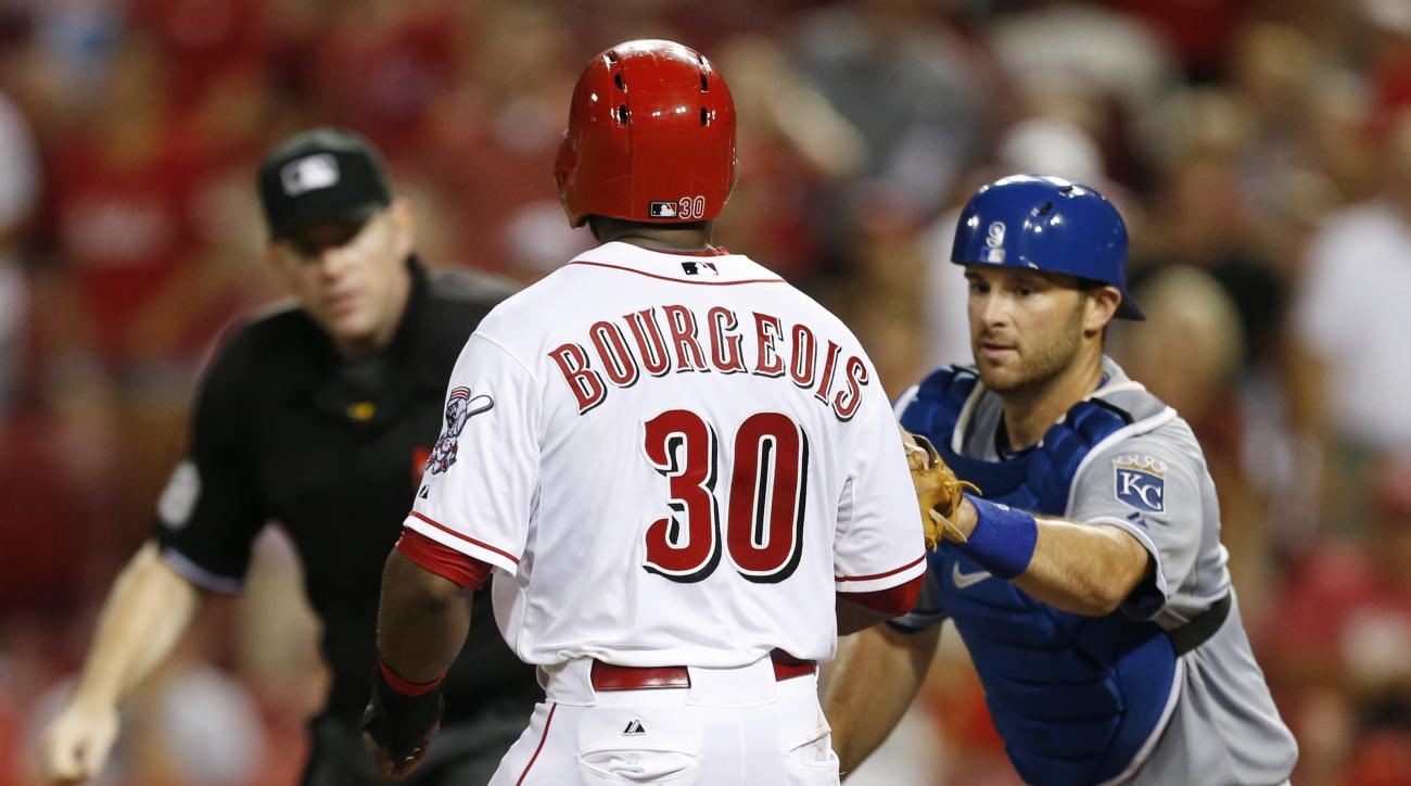 Cincinnati Reds center fielder Jason Bourgeois (30) is tagged out at home plate by Kansas City Royals catcher Drew Butera for the second out of a double play, on infield pop out by Jay Bruce during the fifth inning of a baseball game, Wednesday, Aug. 19,