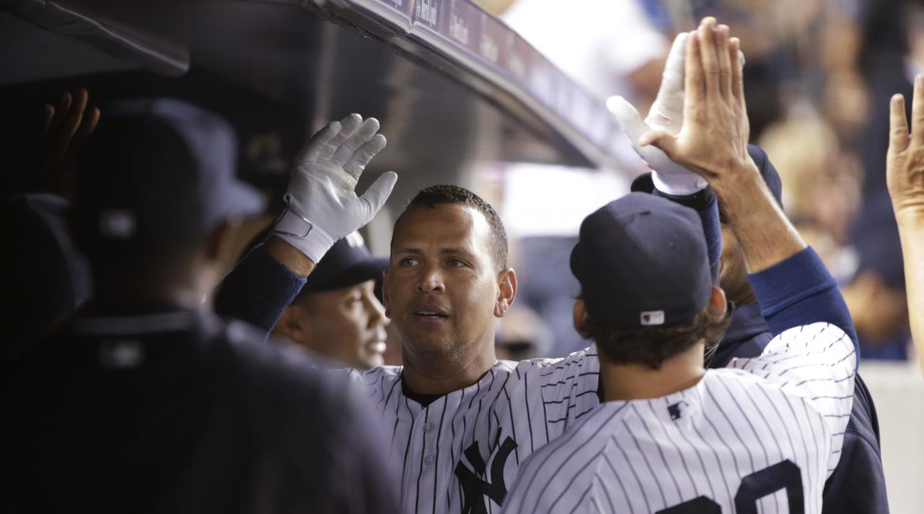 New York Yankees' Alex Rodriguez celebrates with teammates after hitting a home run during the fourth inning of a baseball game against the Cleveland Indians on Thursday, Aug. 20, 2015, in New York. (AP Photo/Frank Franklin II)