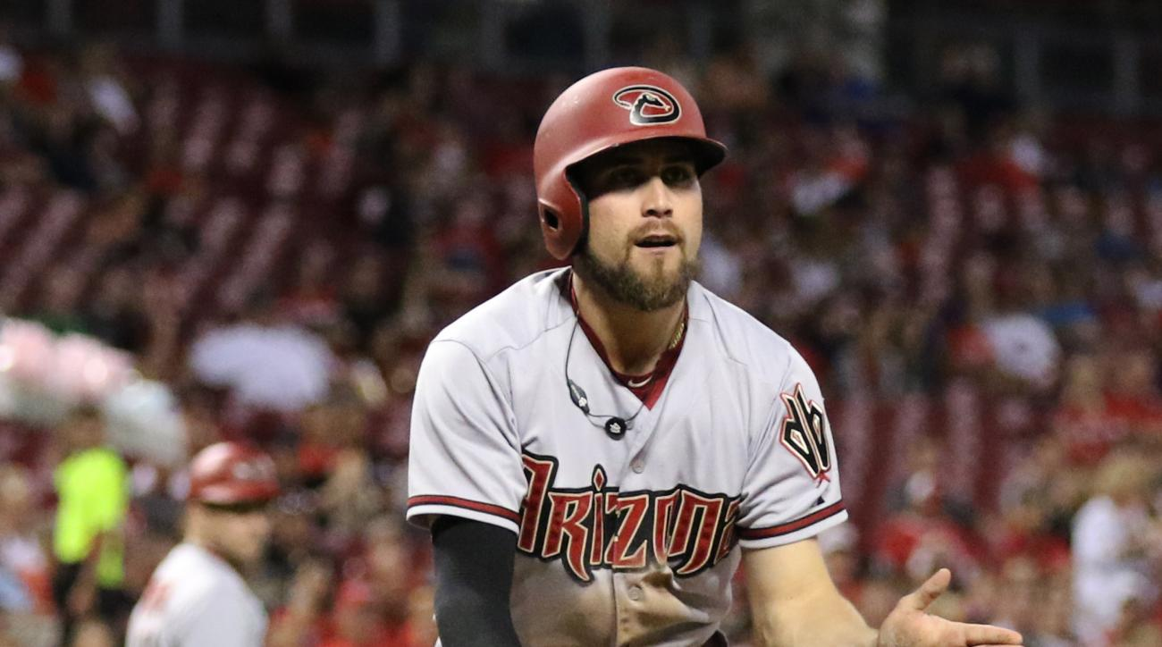 Arizona Diamondbacks' Ender Inciarte celebrates after scoring on a single by A.J. Pollock during the fifth inning of a baseball game against the Cincinnati Reds, Thursday, Aug. 20, 2015, in Cincinnati. (AP Photo/Gary Landers)