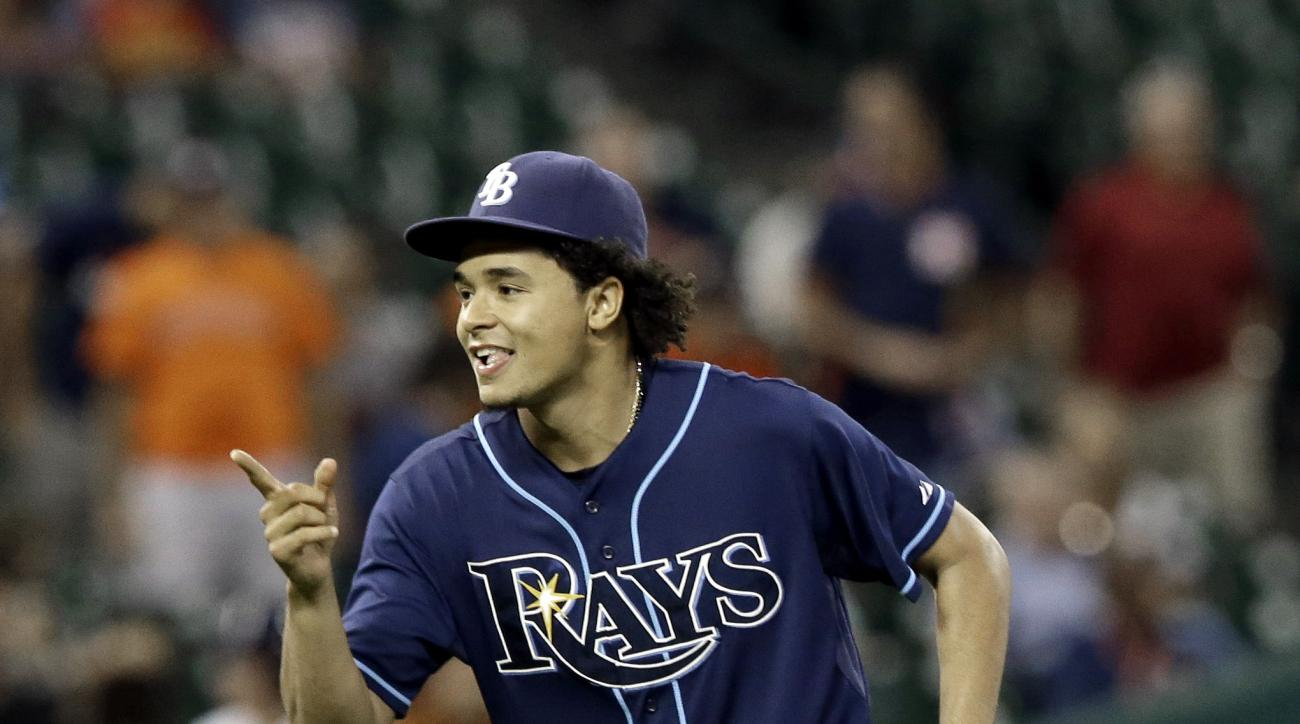 Tampa Bay Rays' Chris Archer celebrates his one-hit complete baseball game to beat the the Houston Astros 1-0, Thursday, Aug. 20, 2015, in Houston. (AP Photo/Pat Sullivan)