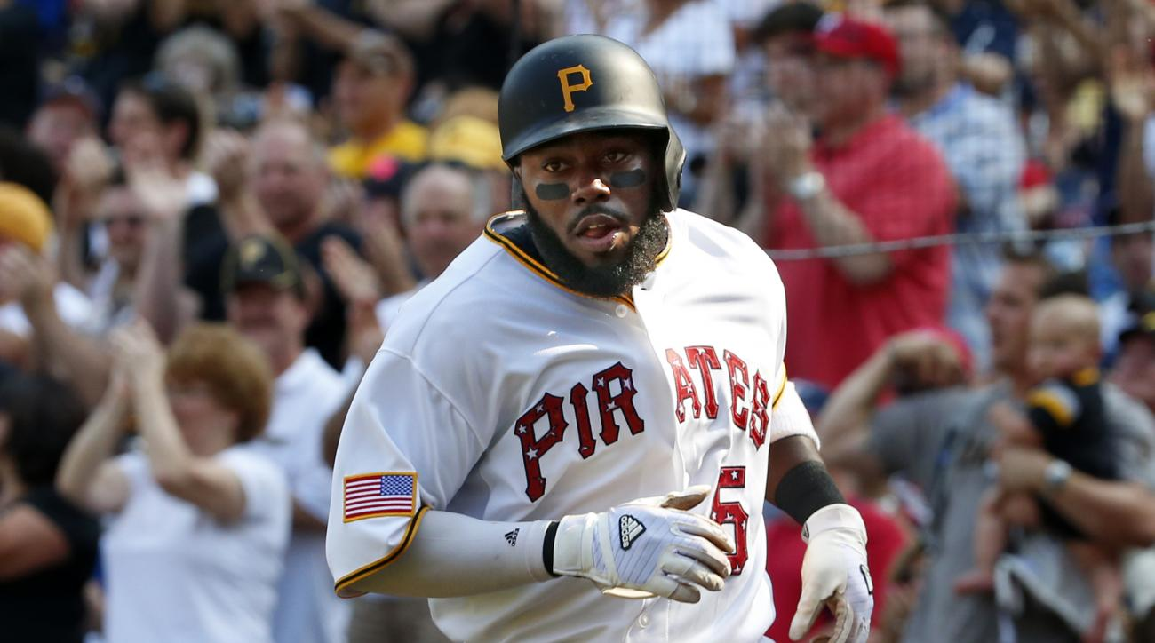 Pittsburgh Pirates' Josh Harrison (5) scores on a single by Pirates' Neil Walker off Cleveland Indians starting pitcher Cody Anderson during the sixth inning of a baseball game in Pittsburgh Saturday, July 4, 2015. It would prove to be the game-winning ru