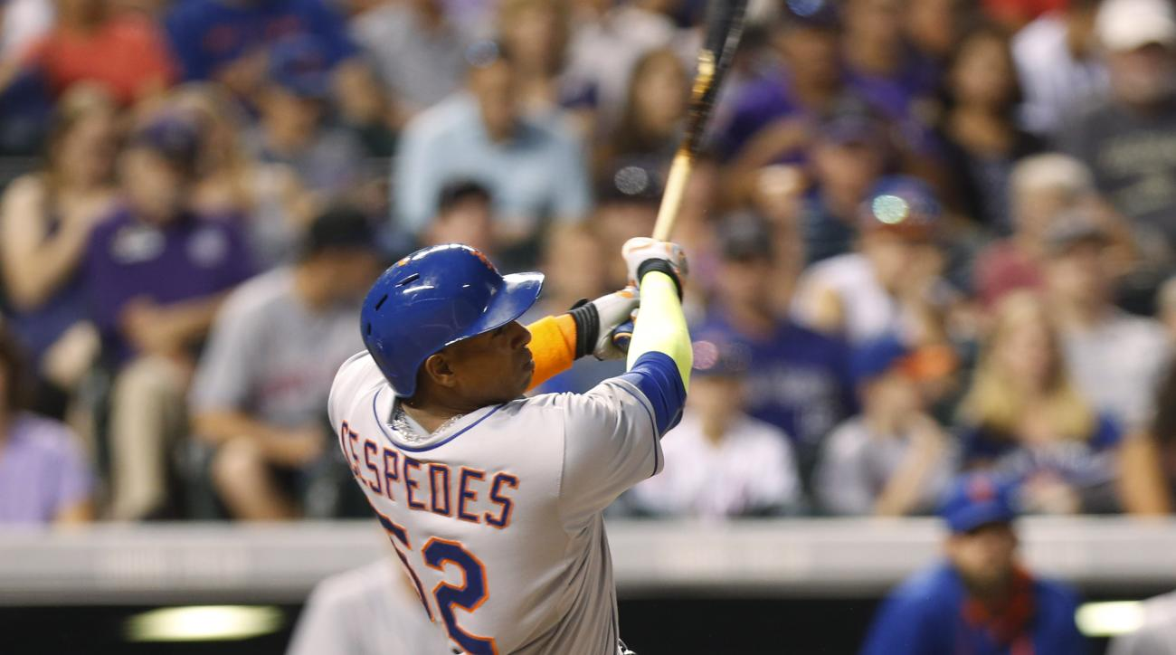 New York Mets' Yoenis Cespedes follows the flight of his solo home run off Colorado Rockies relief pitcher Christian Bergman to lead off the fourth inning of a baseball game Friday, Aug. 21, 2015, in Denver. (AP Photo/David Zalubowski)