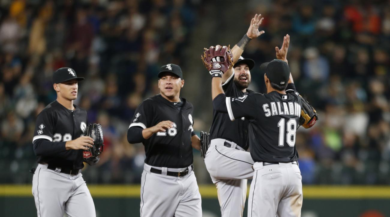 Chicago White Sox players from left, Trayce Thompson, Avisail Garcia, Adam Eaton, and Tyler Saladino celebrate the 11-4 win over the Seattle Mariners in a baseball game Friday, Aug. 21, 2015, in Seattle. (AP Photo/John Froschauer)