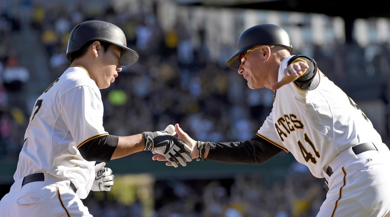 Pittsburgh Pirates' Jung Ho Kang, left, is congratulated by third base coach Rick Sofield after hitting a solo home run off San Francisco Giants' pitcger Mike Leake in the fifth inning of a baseball game, Saturday, Aug. 22, 2015, in Pittsburgh. (AP Photo/