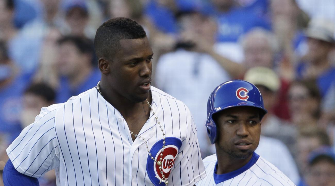 Chicago Cubs' Jorge Soler, left, celebrates with Jonathan Herrera after hitting a solo home run during the eighth inning of a baseball game against the Atlanta Braves Saturday, Aug. 22, 2015, in Chicago. The Cubs won 9-7. (AP Photo/Nam Y. Huh)
